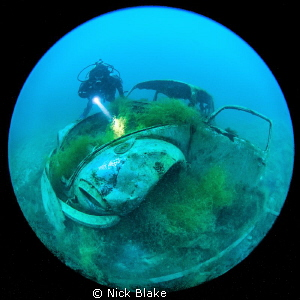 VW Beetle and diver at Capernwray by Nick Blake 